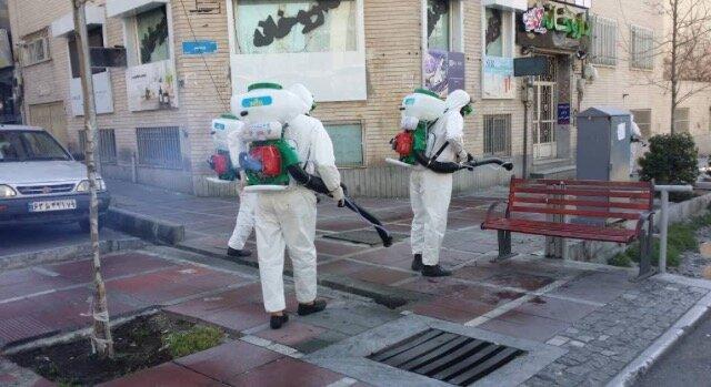ضدعفونی و گندزدایی خیابان ولیعصر توسط 200 گروه شهرداری تهران